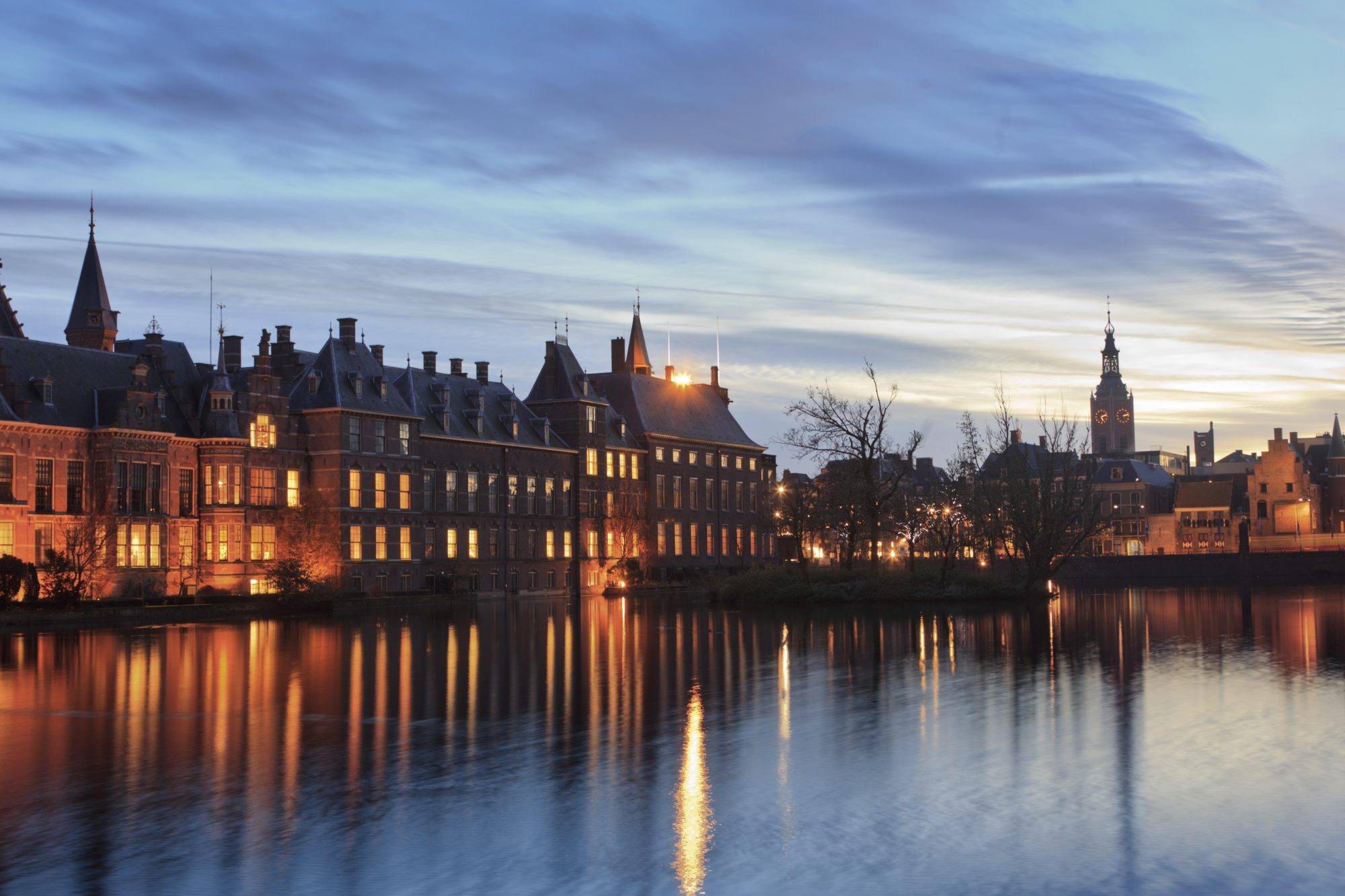 illuminated parliament buildings along the Hofvijver; The Hague, Netherlands